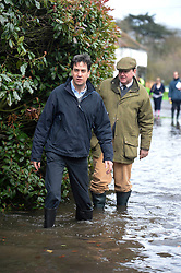 © London News Pictures. 11/02/2014. Wraysbury, UK. Ed Miliband visiting Wraysbury, Berkshire, one of the worst hit flood areas in the south east of England. The area has been hit hard by recent flooding from the nearby Thames River. Photo credit : Ben Cawthra/LNP