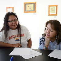 Poet Laurete for the Navajo Nation Laura Tohe, right, reads Juliana George's poem at a poetry workshop, Friday, July 6, at ART123 Gallery.