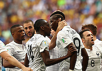 Fifa Soccer World Cup - Brazil 2014 - <br /> FRANCE (FRA) Vs. NIGERIA (NGA) - Round of 16 - Estadio Nacional Brasilia- Brazil (BRA) - 30 Jun 2014 <br /> Here French player Paul POGBA (C) celebrating his goal. French player Blaise MATUIDI (L). Scoring the match 1-0<br /> © PikoPress