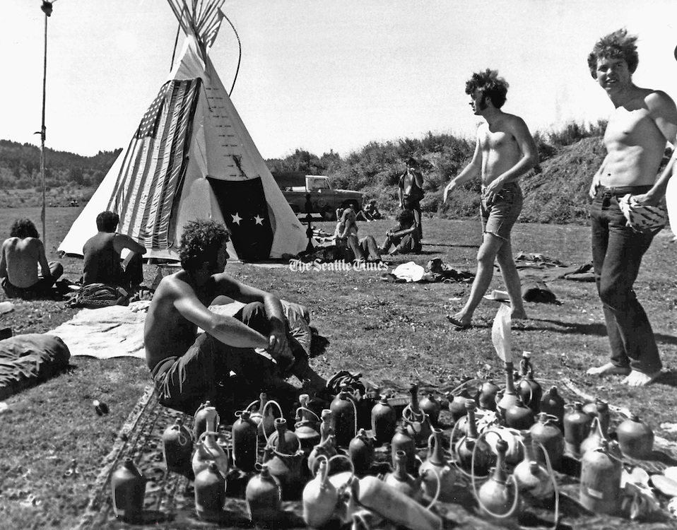 Pottery water pipes were among some of the unusual goods on sale at the Seattle Pops Festival, a rock festival at Gold Creek Park near Woodinville. An Indian teepee decorated with an American flag was in the background. An estimated 50,000 persons attended the festival. (Alden J. Blethen / The Seattle Times, 1969)
