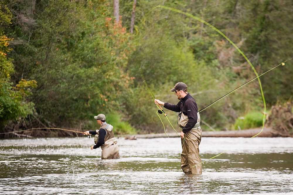 Jeremy Cram and Ryan Klett cast their flies into the Cle Elum River in Eastern Washington.