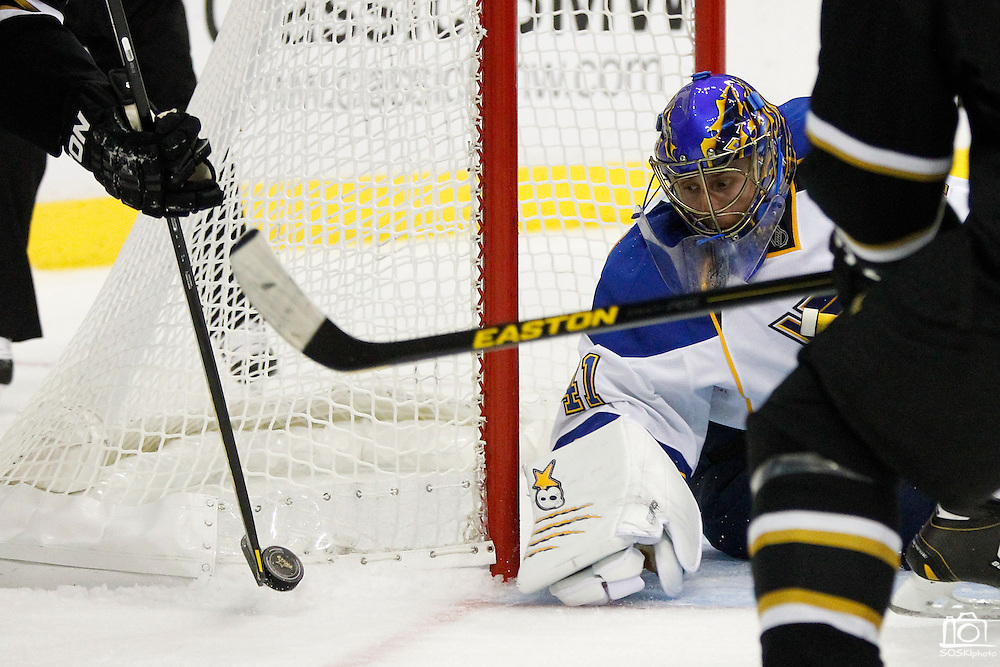 St. Louis Blues goalie Jaroslav Halak (41) watches the puck as Dallas Stars left wing Loui Eriksson (21) attempts to score a goal on a rebound in the third period at the American Airlines Center in Dallas, Texas, on January 26, 2013.  (Stan Olszewski/The Dallas Morning News)