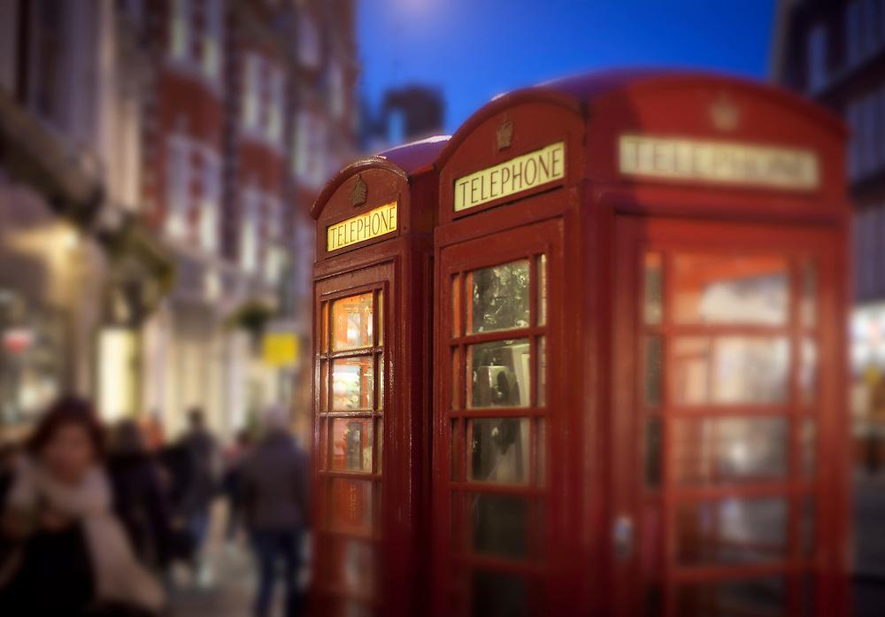 red telephone box at night in Marylebone High Street, London