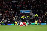a dejected Alex Cuthbert of Wales falls to the pitch on his knees after the final whistle. Rugby World Cup 2015 quarter final match, South Africa v Wales at Twickenham Stadium in London, England  on Saturday 17th October 2015.<br /> pic by  John Patrick Fletcher, Andrew Orchard sports photography.