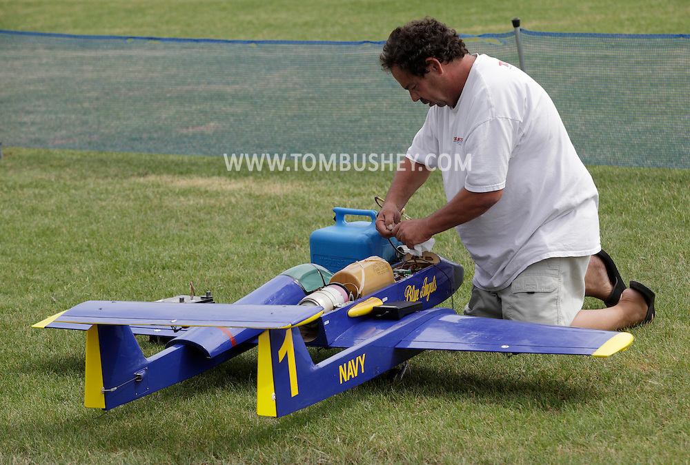 New Hampton, New York - A man works on his remote controlled jet airplane at a fly-in sponsored by the Wawayanda Flying Club on June 5, 2010.