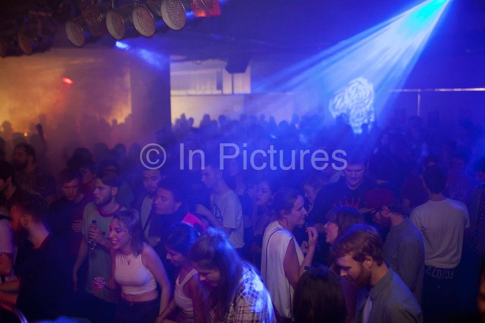 Crowd shot. L-Vis, Bok Bok, 1990, Scratcha DVA, DJs playing at Night Slugs and Dollop club night at the Laundry, London Fields, Hackney, London.