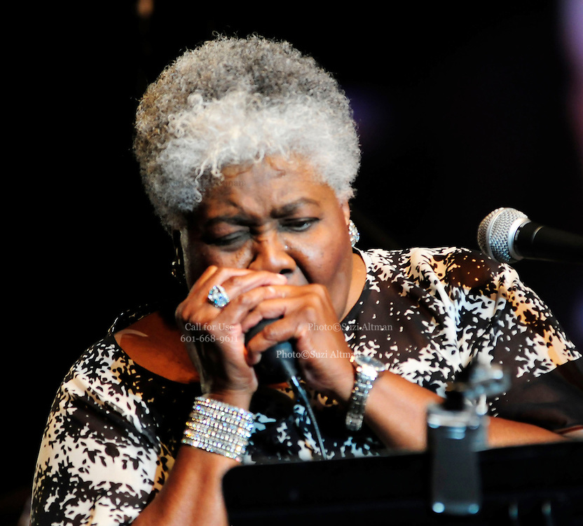 """(Jackson-Mississippi) Grammy award winner for  the song """" Misty Blue""""and Jackson Mississippi native Dorothy Moore, singsand plays the harmonica, a rare treat, during her performance of her hit """"Misty Blue"""" at the first annual Southern Crossroads Music &Tamale Festival Saturday August 11,2012. She was also presented by a proclamation from the mayor of Jackson. Photo © Suzi Altman."""