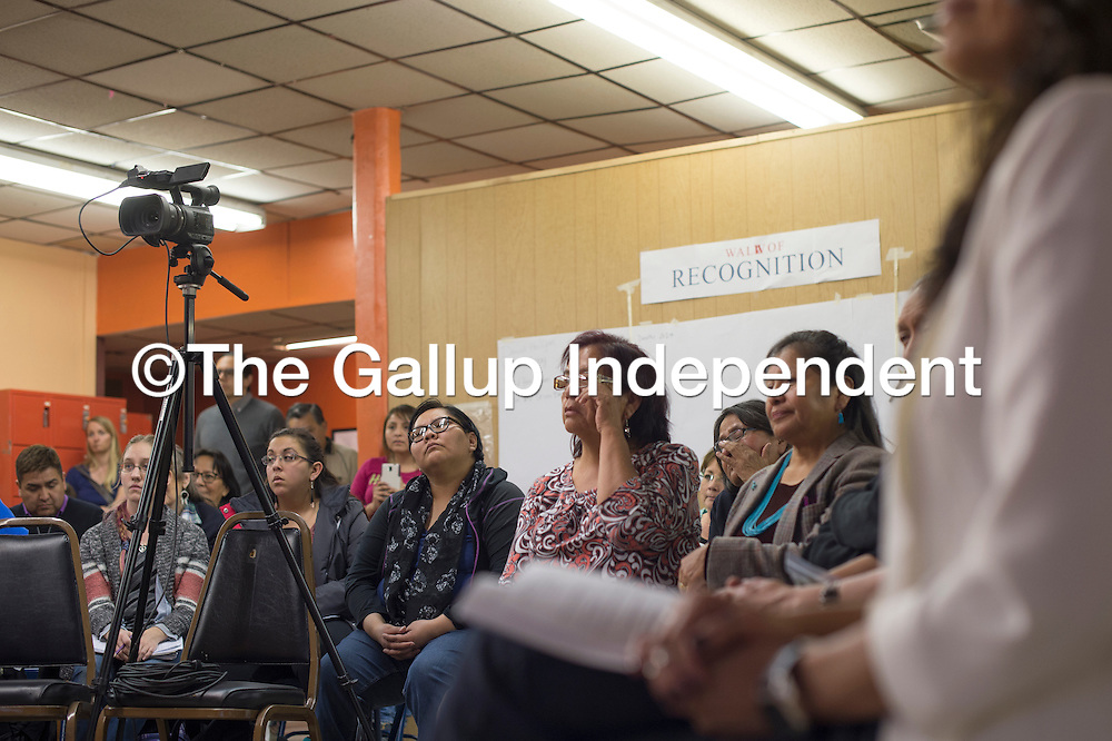 """012815      Cayla Nimmo<br /> <br /> A full crowd gathers at the Wednesday night forum, """"Gallup: A Border Town of Violence,"""".at the Hozho Center in Gallup, some people wipe tears from their eyes in response to the personal stories shared."""