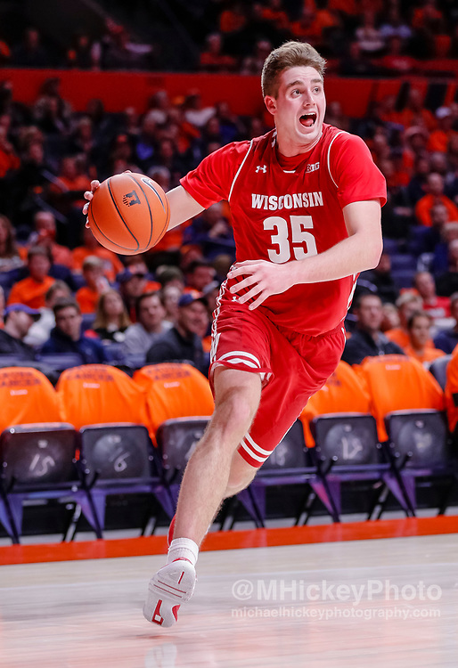 CHAMPAIGN, IL - JANUARY 23: Nate Reuvers #35 of the Wisconsin Badgers drives to the basket during the game against the Illinois Fighting Illini at State Farm Center on January 23, 2019 in Champaign, Illinois. (Photo by Michael Hickey/Getty Images) *** Local Caption *** Nate Reuvers