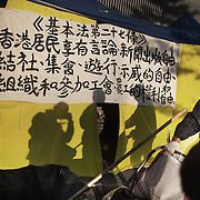 """Writing on a tent wall in what is left of the Umbrella Movement tent city next to the Central Government Offices. <br /> The text says: <br /> """"Article 27.<br /> Hong Kong residents shall have freedom of speech, of the press and of publication; freedom of association, of assembly, of procession and of demonstration; and the right and freedom to form and join trade unions, and to strike.<br /> <br /> """" Hong Kong (香港; """"Fragrant Harbour""""), officially known as Hong Kong Special Administrative Region of the People's Republic of China since the hand-over from the United Kingdom in 1997 under the principle of """"one country, two systsems"""".  7 million people live on 1,104km square, making it the most vertivcal city in the world. Hong Kong is one of the world's leading financial centres along side London and New York, it has one of the highest income per capita in the world as well the moste severe income inequality amongst advanced economies. The Hong Kong civil society is highly regulated but has at the same time one of the most lassiez-faire economies with low taxation and free trade. Civil unrest and political dissent is unusual but in 2014 the Umbrella Movenment took to the streets of Hong Kong demanding democracy and universal suffrage. 93 % are ethnic Chinese, mostly Cantonese speaking."""