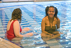 Day service users relaxing in the water at a local swimming pool,