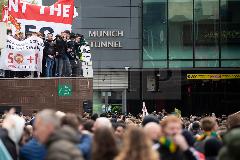 © Licensed to London News Pictures.02/05/2021. Manchester, UK. Hundreds protest owners of the club at Old Trafford Stadium ahead of the Manchester United fixture against Liverpool. Police dispersed the crowd before kick-off. Photo credit: Kerry Elsworth/LNP