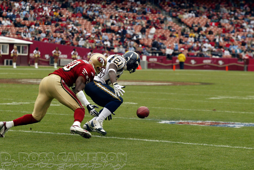 San Diego Chargers' LaDainian Tomlinson, right, drops a pass in front of San Francisco 49ers cornerback Mike Adams in the fourth quarter of their NFL football game, Sunday, Oct. 15, 2006 in San Francisco. The Chargers won, 48-19. (D. Ross Cameron/The Oakland Tribune)