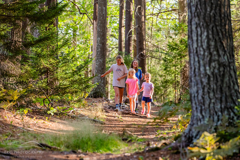 Girls explore the Woodward Point Preserve on the New Meadows River in Brunswick, Maine.