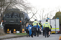 © Licensed to London News Pictures. 15/03/2018. Alderholt, UK. Military vehicles and emergency response units are seen at n address in Alderholt, Dorset, believed to be the home of Wiltshire Police Detective Sergeant Nick Bailey, in connection with the poisoning of Former Russian spy Sergei Skripal and his daughter Yulia were. The couple where found unconscious on bench in Salisbury shopping centre. Photo credit: Ben Cawthra/LNP