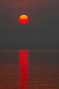 Red African Sun setting over Lake Kariba, Zimbabwe