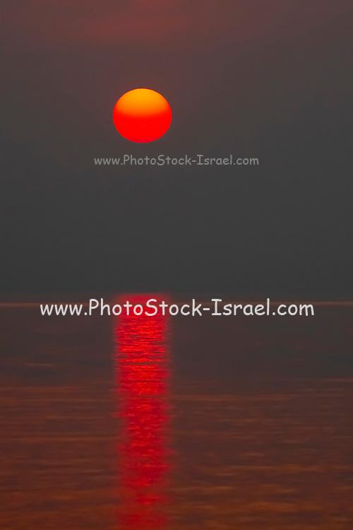 Red African Sun setting over Lake Kariba, Zimbabwe