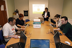 A group of people involved in Workers Educational Association Computer training workshop,