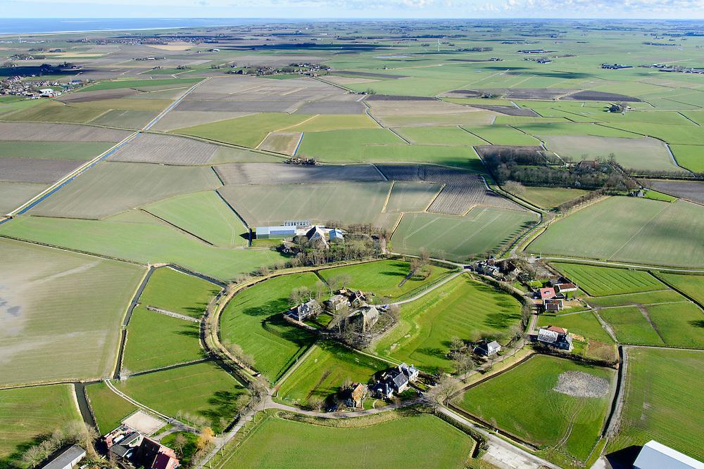 Nederland, Friesland, Gemeente Ferweradeel, 28-02-2016; Hogebeintum (Fries: Hegebeintum), terpdorp. De terp is de hoogste van Friesland, maar alleen het deel met het kerkje heeft de oorspronkelijke hoogte, de rest van de terp is afgegraven, de vruchtbare grond diende als mest. Hogebeintum, Mound village. The terp (mound) is the highest of Friesland, but only the part with the church has the original height, the rest of the mound has been excavated, the fertile ground served as fertilizer.<br />  <br /> luchtfoto (toeslag op standard tarieven);<br /> aerial photo (additional fee required);<br /> copyright foto/photo Siebe Swart