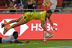 2018?4?29?.???????——HSBC???????????????????——????..4?29????????John Porch???6??????????????????HSBC???????????????????????????28?22??????????.???? ??????..Australia's player John Porch (R, no 6 yellow jersey) leaps to score a try during the finals of the HSBC World Rugby Sevens Series Singapore held in Singapore's National Stadium on Apr 29, 2018. Today, Fiji won against Australia with a score of 28 to 22..By Xinhua, Then Chih Wey..????????????2018?4?29? (Credit Image: © Then Chih Wey/Xinhua via ZUMA Wire)