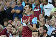 a West Ham United fan shows his frustration during the 2nd half. UEFA Europa league, 1st play off round match, 2nd leg, West Ham Utd v Astra Giurgiu at the London Stadium, Queen Elizabeth Olympic Park in London on Thursday 25th August 2016.<br /> pic by John Patrick Fletcher, Andrew Orchard sports photography.