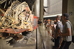 Sept. 4, 2014 - New York, New York, US - Two visitors, Christoph Mueller (2nd R) and Timo Kellermann (R) examine a fire engine that was completely destroyed in the terrorist attacks on 11 September 2001, at the 9/11 Museum in New York, USA, 4 September 2014. The museum commemorates the 3000 victims who died when the twin towers of the former World Trade Centre collapsed in the terrorist attacks. Photo:  Chris Melzer/dpa (Credit Image: © Chris Melzer/DPA/ZUMA Wire)