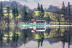 © Licensed to London News Pictures. 06/03/2020. Glenridding UK. Ullswater steamer the M.V Western Belle built in 1935 crosses the calm water of Ullswater lake this morning on route from Glenridding to Pooley Bridge in Cumbria. Photo credit: Andrew McCaren/LNP