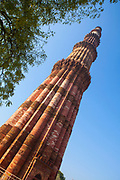 "The Qutb Minar, is a victory tower"" that forms part of the Qutb complex, rhe tallest brick minaret in the world"