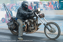Racing a Harley-Davidson Knucklehead chopper at the Sturgis Dragway race finals on Wednesday during the annual Black Hills Motorcycle Rally. Sturgis, SD, USA. August 6, 2014.  Photography ©2014 Michael Lichter.