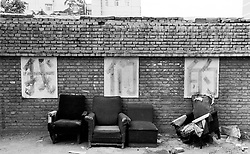 """Old sofas in a Beijing hutong - writing says """"Ours"""""""