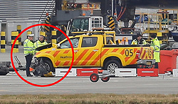 **Red circle indicated damage to the front of the vehicle**<br /> © Licensed to London News Pictures. 14/02/2018. London, UK. Police and airport vehicles are seen in the tarmac at Heathrow Airport after this morning's incident near T5.Photo credit: Peter Macdiarmid/LNP
