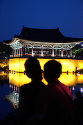 "Lovers enjoying the evening at Anapji pond in the city of Gyeongju. Gyeongju was the capital of the ancient kingdom of Silla (57 BC - 935 AD) which ruled most of the Korean Peninsula between the 7th and 9th centuries. A vast number of archaeological sites and cultural properties from this period remain in the city. Gyeongju is often referred to as ""the museum without walls"". / Gyeongju, South Korea, Republic of Korea, KOR, 10th of May 2010."