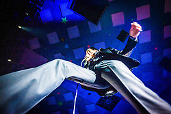 A wide angle shot of the frontman Nick Cave passing over the photo pit, Nick Cave and the Bad Seeds, on stage tonight at The Barrowlands, Glasgow, Scotland.<br /> ©Michael Schofield.