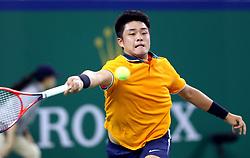 SHANGHAI, Oct. 10, 2018  China's Wu Yibing hits a return during the men's singles second round match against Japan's Kei Nishikori at the Shanghai Masters tennis tournament on Oct. 10, 2018. Wu Yibing lost 1-2. (Credit Image: © Fan Jun/Xinhua via ZUMA Wire)