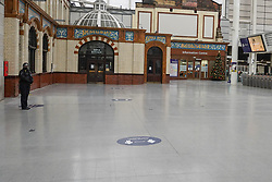 © Licensed to London News Pictures. 31/12/2020. Manchester , UK.  Manchester Victoria train station is seen deserted this morning.  The county of Greater Manchester from Thursday 31 December will move into Tier 4 following a spike in coronavirus cases. Photo credit:  Ioannis Alexopoulos/LNP