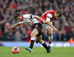 Liverpool's Joe Allen and Arsenal's Mathieu Flamini battle for the ball - Photo mandatory by-line: Matt Bunn/JMP - Tel: Mobile: 07966 386802 16/02/2014 - SPORT - FOOTBALL - Emirates Stadium - London - Arsenal v Liverpool - FA Cup - Fifth Round