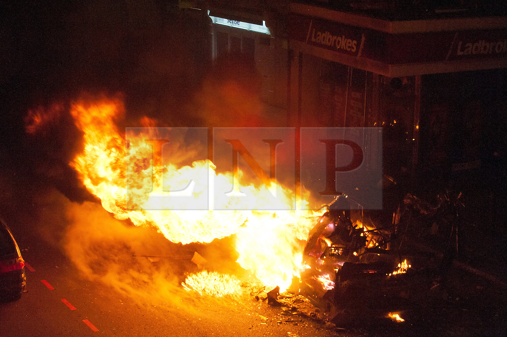 licensed to London News Pictures. London, UK. 7th August 2011. Rioting in Tottenham, London. A double-decker bus burns. Violence and looting breaks out from Tottenham High Road after the police shooting of 29-year-old Mark Duggan. Please see special instructions for usage rates. Photo credit should read Jules Mattsson/LNP
