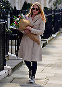 © Licensed to London News Pictures. 08/04/2013. London, UK Flowers left at the house where former Conservative Prime Minister Margaret Thatcher lived in central London. Lady Thatcher dies this mooring from a suspected stroke. Photo credit : Stephen Simpson/LNP