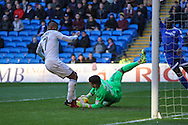 Cardiff City goalkeeper Brian Murphy saves from the feet of Leandro Bacuna of Aston Villa during the EFL Sky Bet Championship match between Cardiff City and Aston Villa at the Cardiff City Stadium, Cardiff, Wales on 2 January 2017. Photo by Andrew Lewis.