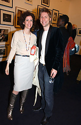 MOLLIE DENT-BROCKLEHURST and CHRISTOPHER BAILEY creative director of Burberry at a party to celebrate the opening of Photo-London 2006 at Burlington Gardens, London W1 on 17th May 2006.<br />