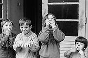 """Child refugees from Bosnia in the Varazdin refugee camp in Croatia in the winter of 1992. The boy on the left is (probably named) """"Elvis""""."""
