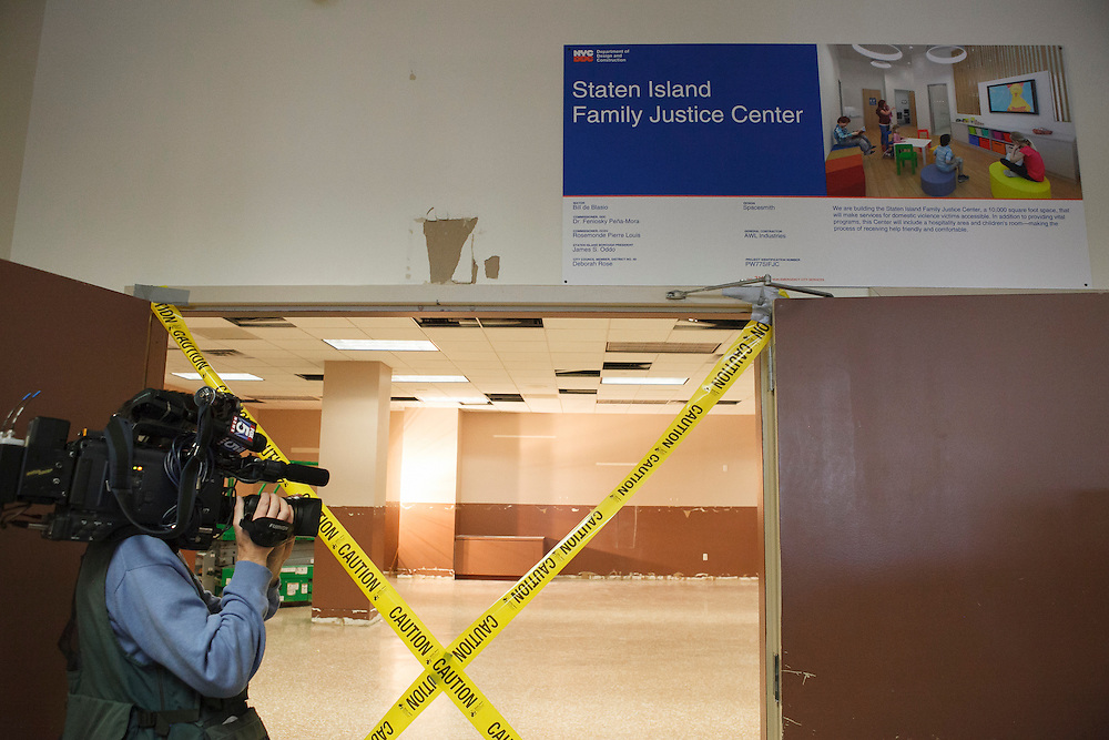 A cameraman at the groundbreaking of the Staten Island Family Justice Center, 126 Stuyvesant Place, Staten Island, NY on Monday, Oct. 5, 2015.<br /> <br /> Andrew Hinderaker for The Wall Street Journal<br /> NYSTANDALONE