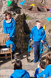 Pictured: Beach Wheelchairs Charity opening. 23 March 2019  Pictured: A disabled boy talks about how the charity Beach Wheelchairs has helped him. Beach Wheelchairs celebrates opening of a new storage area in the harbour. Beach Wheelchairs is a Scottish Charity which has helped nearly 500 individuals to get on the beaches at North Berwick. It relies on volunteers to help disabled people access the beaches. The unveiling of a plaque at the new storage facility which has been named 'Len's Place took place. Len was a stalwart of the local community and was a volunteer involved in the project. <br /> Sally Anderson / EdinburghElitemedia.co.uk<br /> Reproduction fee payable to<br /> Edinburgh Elite Media