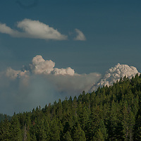 Smoke from a forest fire billows over the Gallatin Range of the Rocky Mountains near Bozeman, Montana.