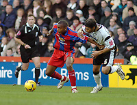 Photo: Kevin Poolman.<br />Derby County v Crystal Palace. Coca Cola Championship. 16/12/2006. Clinton Morrison of Palace shrugs off Dean Leacock of Derby.