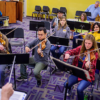 Strings, horns and percussion play together as the Red Rock String Ensemble during rehearsal at Miyamura High School in Gallup Sunday.