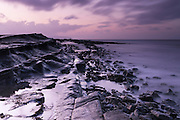 Long exposure from the east end of Kilve Beach looking west, along one of the shelves on an outgoing tide at dusk