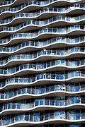 A man on the balcony of his high-rise property apartment looks out over the Royal Victoria Docks in Canning Town, Newham, on 11th August 2021, in London, England.