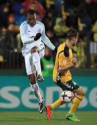 England's Daniel Sturridge (left) and Lithuania's Arturas Zulpa battle for the ball during the 2018 FIFA World Cup Qualifying Group F match at the LFF Stadium, Vilnius.