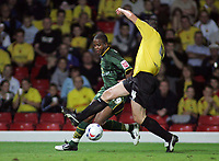 Photo: Paul Thomas.<br /> Watford v Norwich. Coca Cola Championship.<br /> 13/09/2005.<br /> <br /> Norwich's Kevin Lisbie tries to get past Watford defender Malky Mackay.